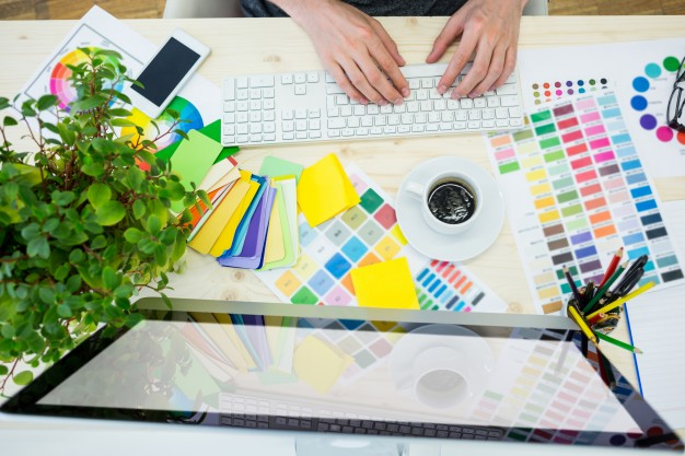hands-of-male-graphic-designer-using-computer_1170-873